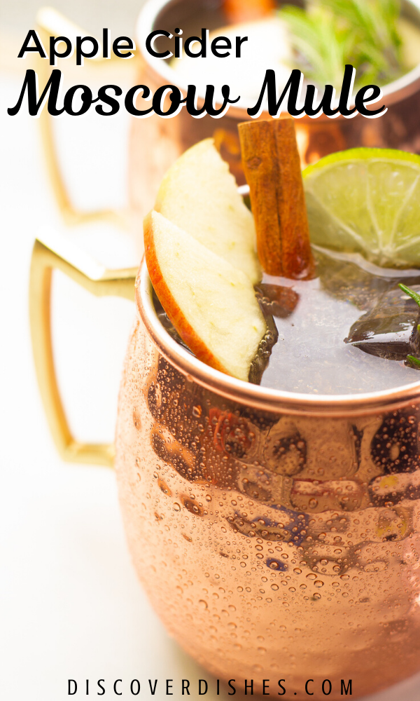 "A close up of an apple cider moscow mule with text that reads ""apple cider moscow mule""."